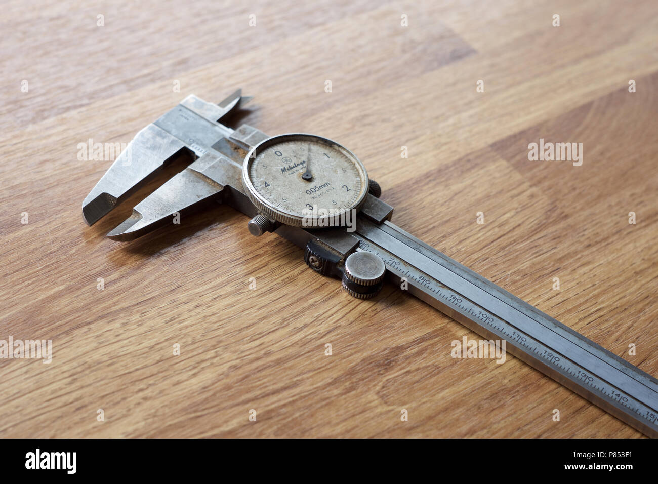 Metric analogue vernier gauge on the work bench. - Stock Image