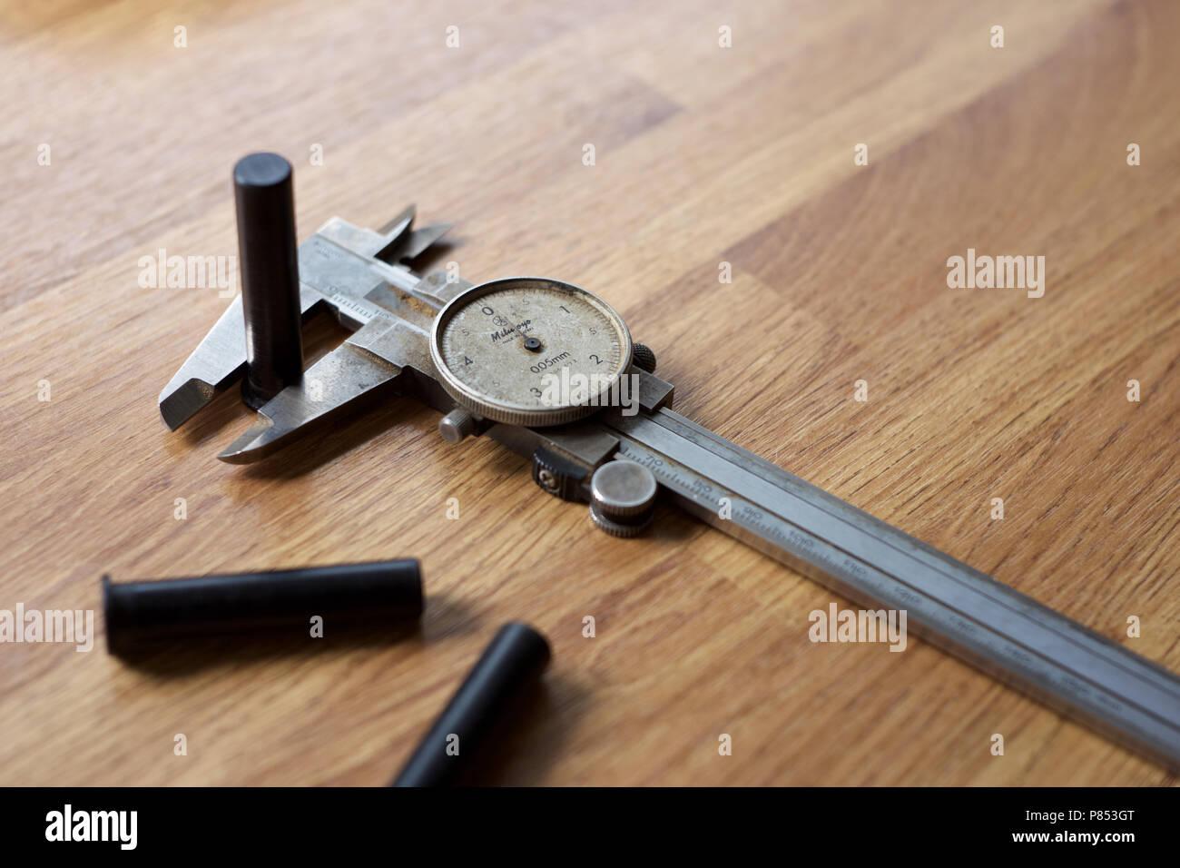 Metric analogue vernier gauge on the work bench. - Stock Image