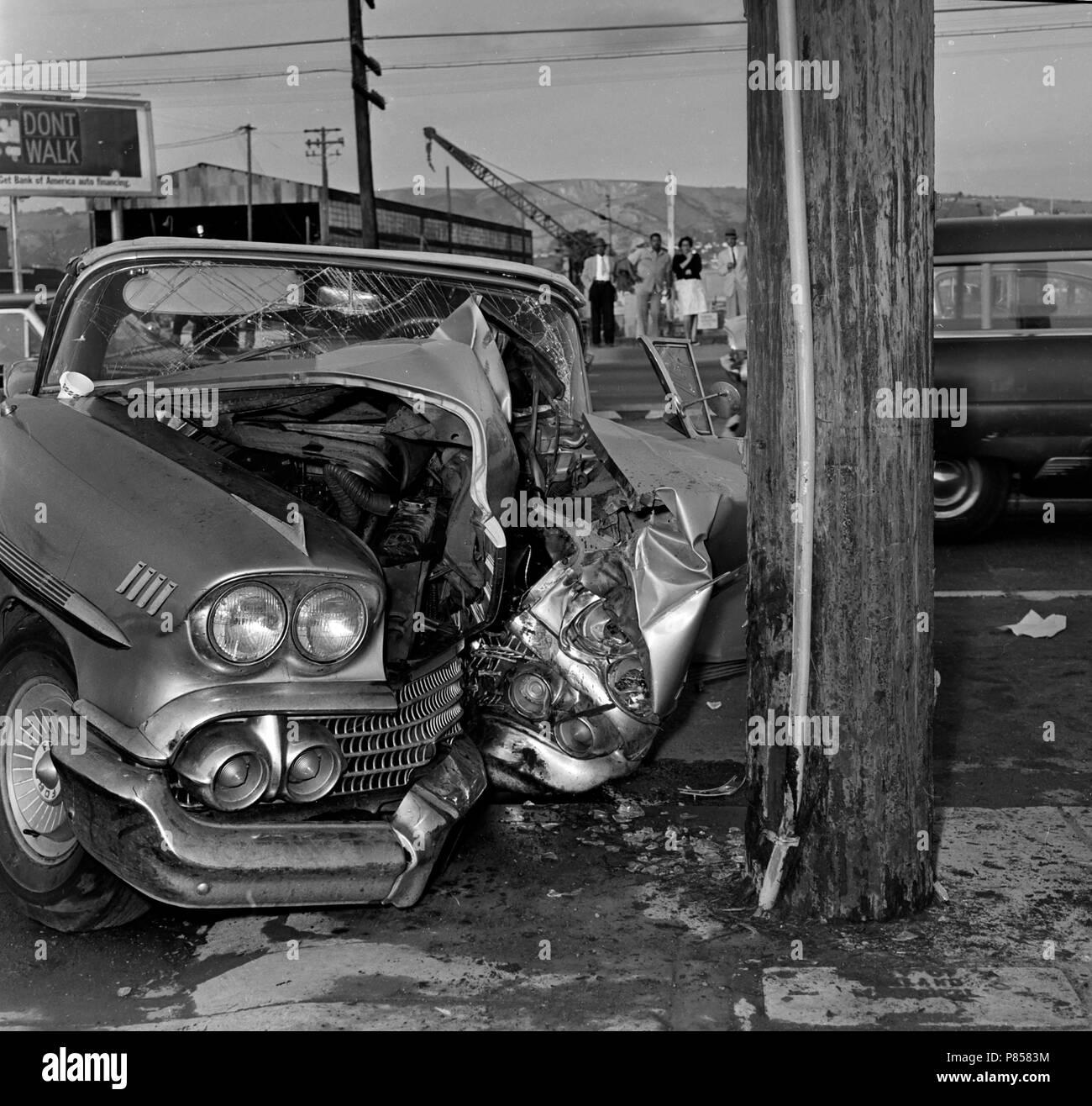 Telephone pole vs car accident in California, ca. 1963. - Stock Image