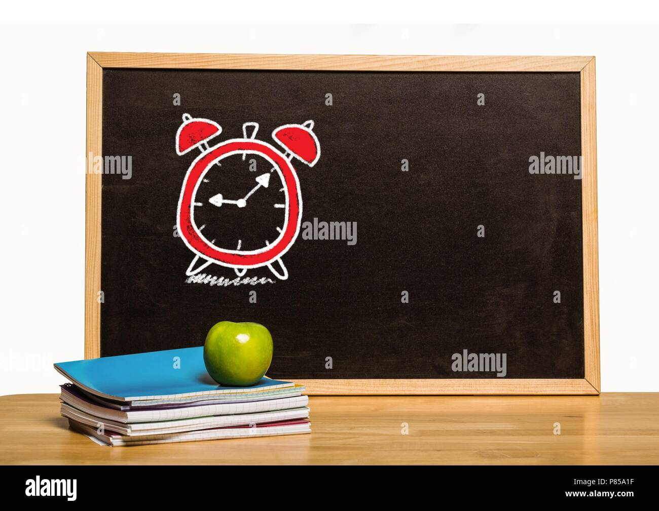 Time clock education drawing on blackboard for school Stock Photo