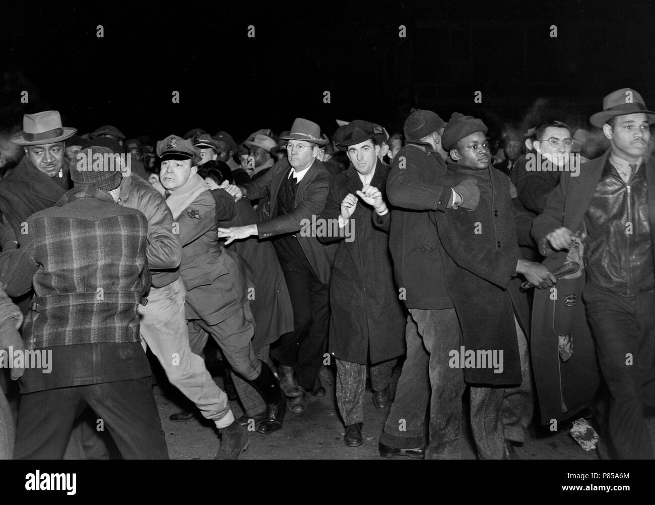 Pushing and shoving breaks out along a picket line at a meatpacking plant in Kansas City, MO, ca. 1946. - Stock Image