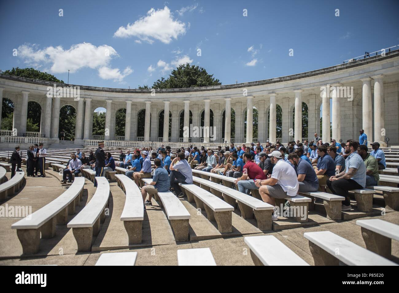 U.S. Army Col. Jerry Farnsworth (center), chief of staff, Arlington National Cemetery and Army National Military Cemeteries, speaks with members of the Detroit Lions inside of the Memorial Amphitheater at Arlington National Cemetery, Arlington, Virginia, June 12, 2018, June 12, 2018. The Lions visited Arlington National Cemetery to participate in an educational staff ride where they spoke with cemetery representatives, field operations, received a tour of the Memorial Amphitheater Display Room from ANC historians, and watched the Changing of the Guard Ceremony at the Tomb of the Unknown Soldie - Stock Image