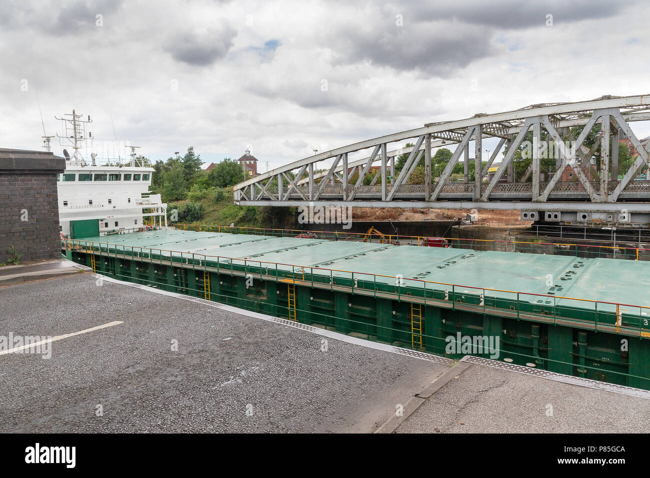 Arklow Rebel, a 13 year old General Cargo Ship from Ireland travels along the Manchester Ship Canal, through the open Swing Bridge at Stockton Heath Stock Photo