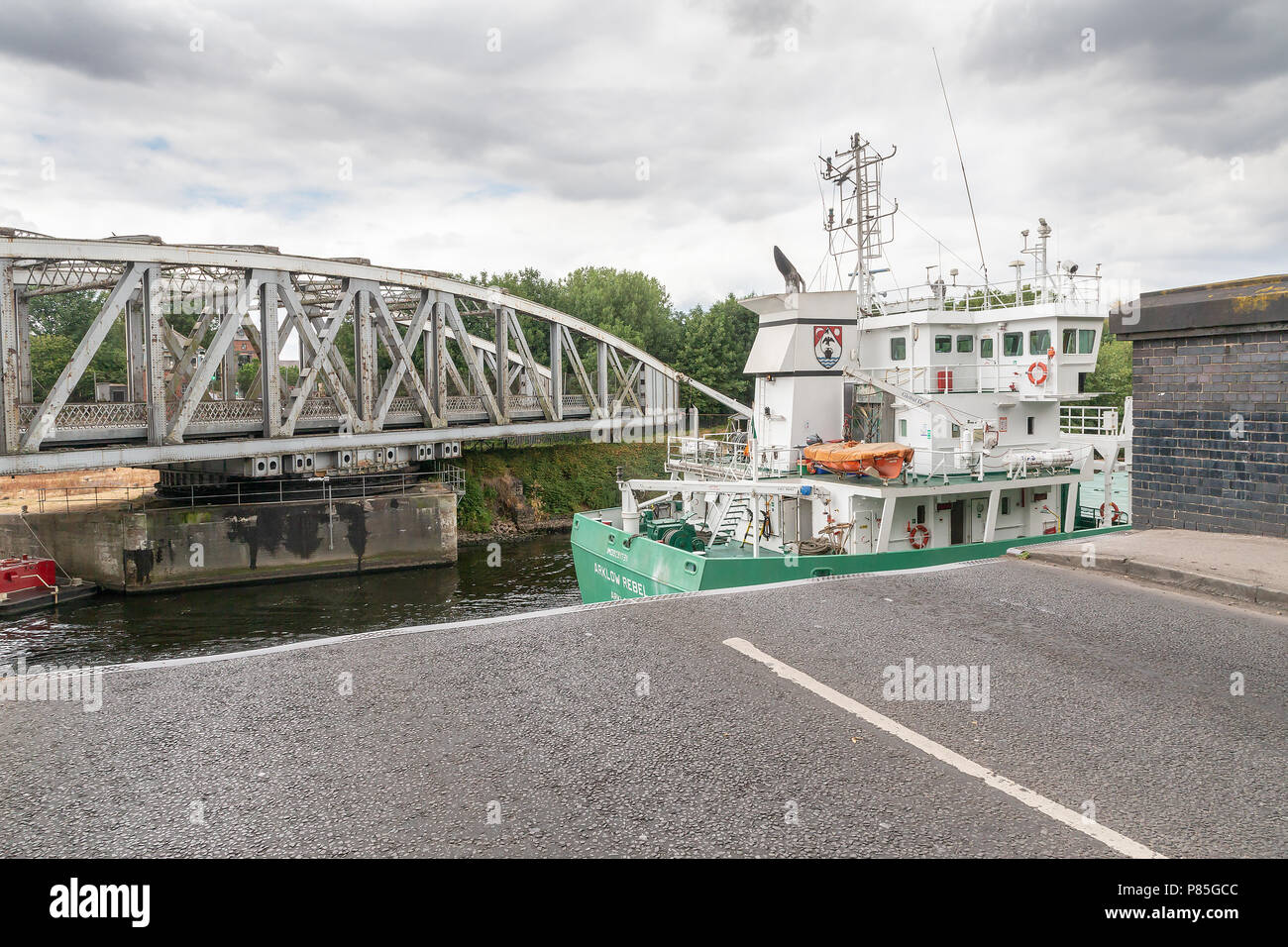 Arklow Rebel, a 13 year old General Cargo Ship from Ireland travels along the Manchester Ship Canal, through the open Swing Bridge at Stockton Heath - Stock Image