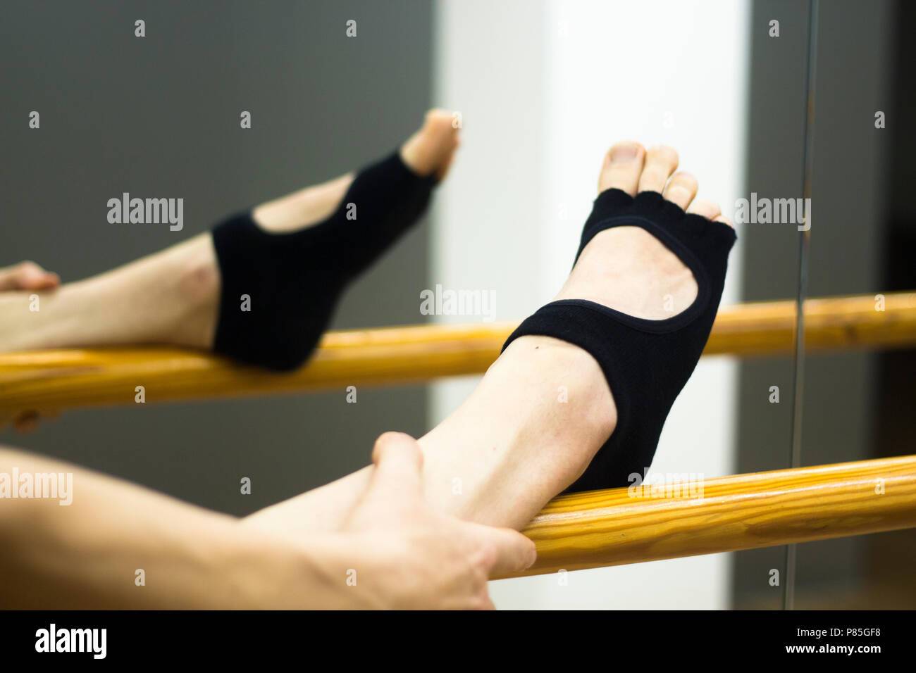 Pilates And Ballet Fitness Stretching And Yoga Studio Gym Bar Equipment And Dancer Stretching Stock Photo Alamy