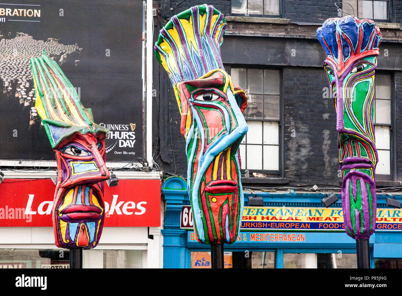 Colourfully decorated sculptured heads in a street in Dublin, Ireland, Europe. Stock Photo