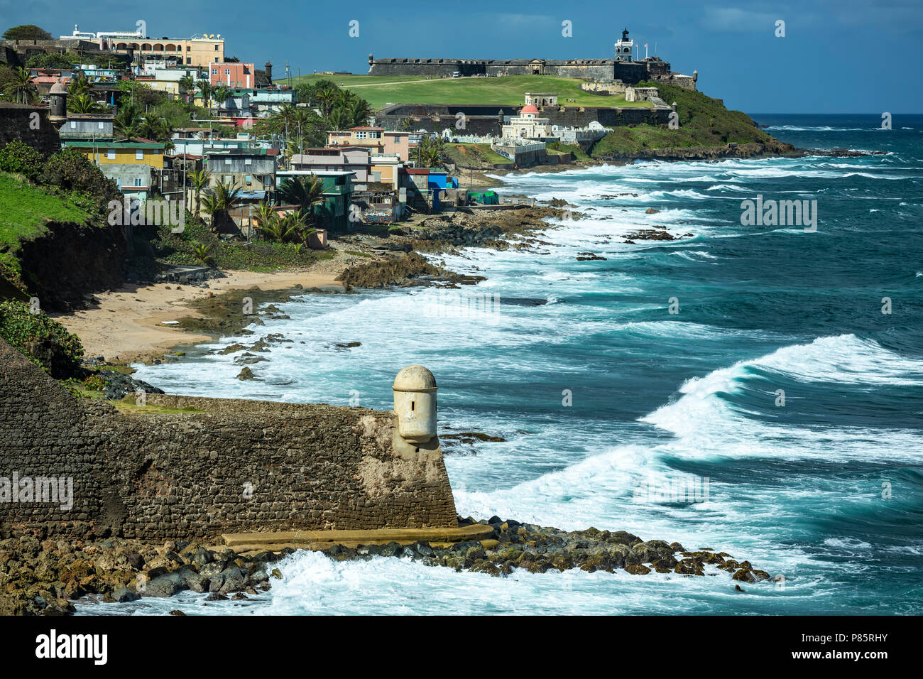 Garita del Diablo (Devil's Sentry Box), San Cristobal Castle (foreground), La Perla Barrio and San Felipe del Morro Castle (in distance), San Juan Nat Stock Photo