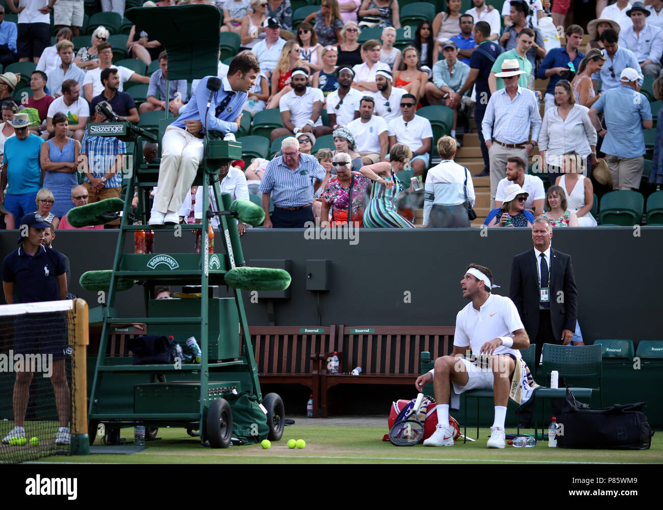 Juan Martin Del Potro speaks to the umpire after receiving a code violation on day seven of the Wimbledon Championships at the All England Lawn Tennis and Croquet Club, Wimbledon. PRESS ASSOCIATION Photo. Picture date: Monday July 9, 2018. See PA story TENNIS Wimbledon. Photo credit should read: Steven Paston/PA Wire. RESTRICTIONS: Editorial use only. No commercial use without prior written consent of the AELTC. Still image use only - no moving images to emulate broadcast. No superimposing or removal of sponsor/ad logos. Call +44 (0)1158 447447 for further information. - Stock Image