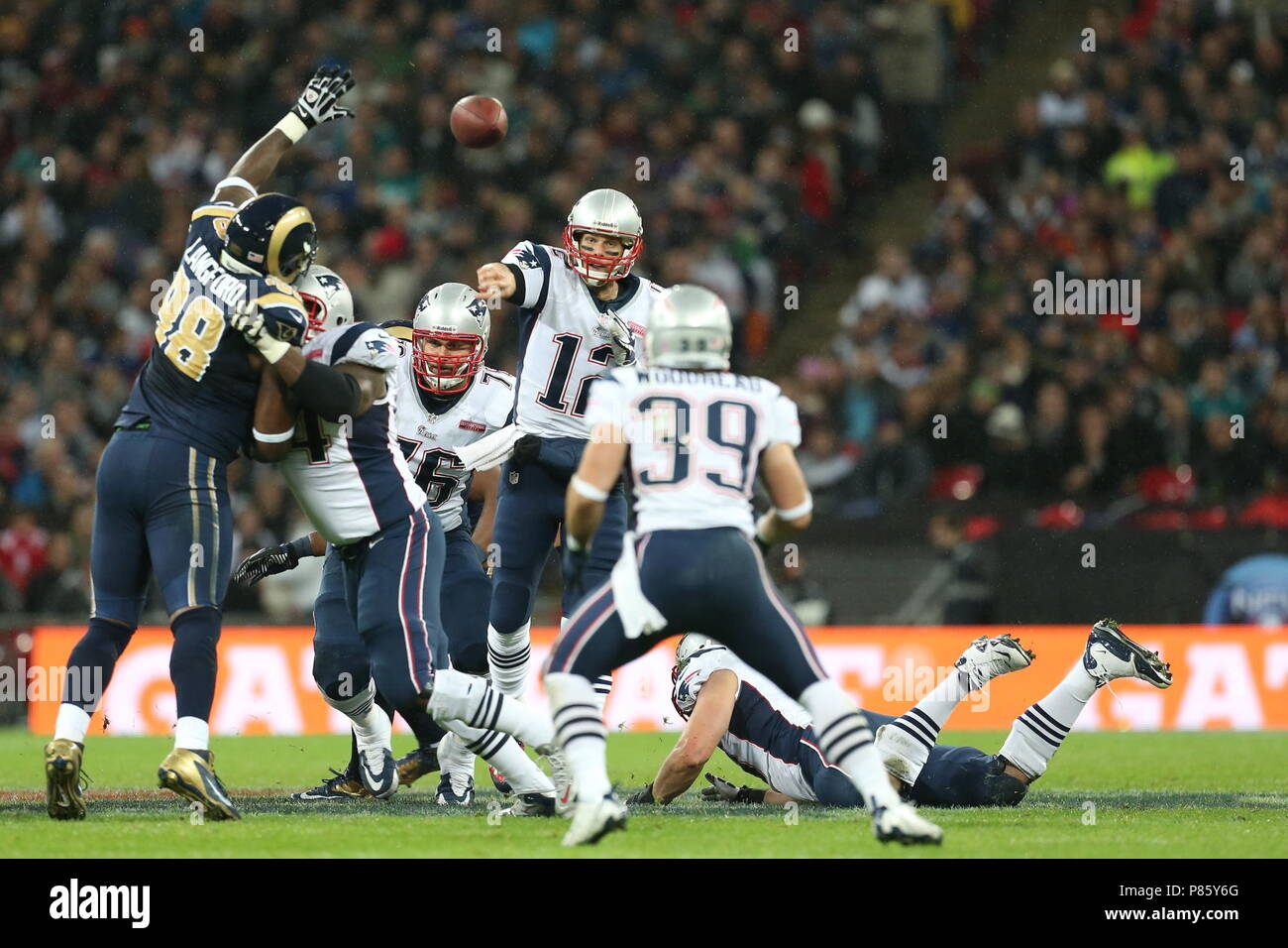New England Patriots quarterback Tom Brady looks for the pass in the fourth quarter against the St. Louis Rams during the NFL International Series 2012 game at Wembley Stadium 28 October. Tom Brady is the most successful quarterback in NFL history with 6 Superbowl Winners Rings --- Photo by Paul Cunningham - Stock Image