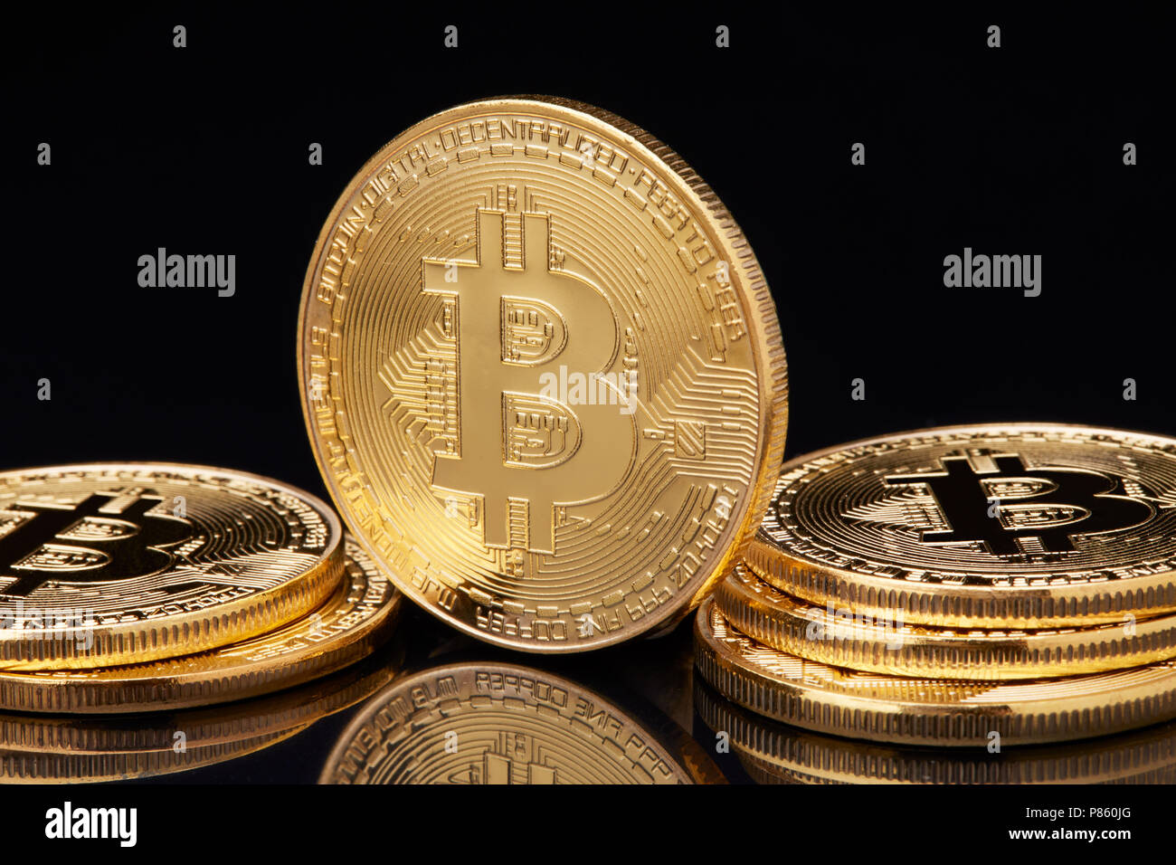 Bitcoin. Crypto currency Gold Bitcoin, BTC, Bit Coin. Macro shot of Bitcoin coins isolated on black background Blockchain technology, bit-coin mining  - Stock Image