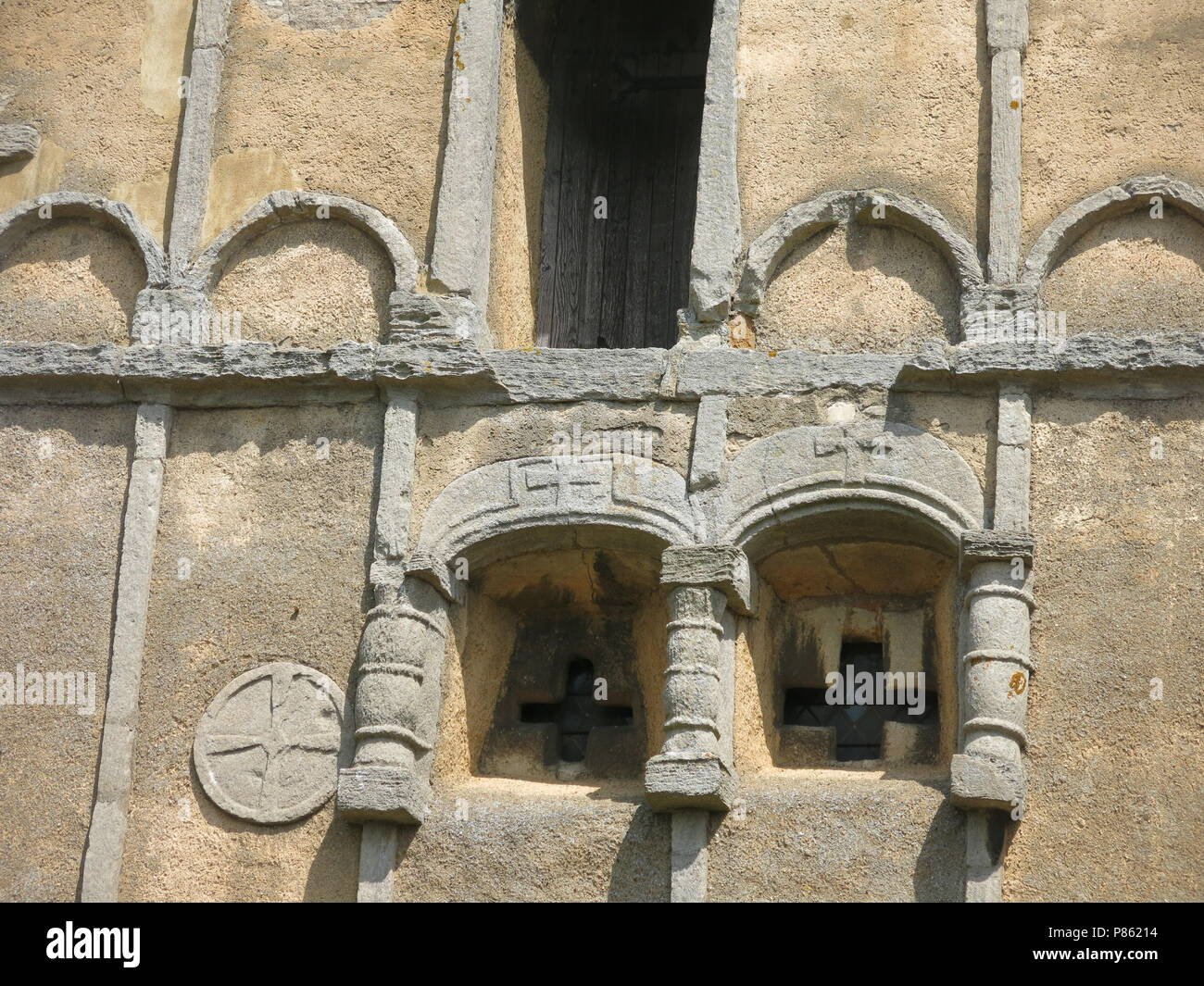 An exterior view of the 10th century Saxon church at Earls Barton, Northamptonshire, England; the construction of the stone tower dates from 970AD. - Stock Image