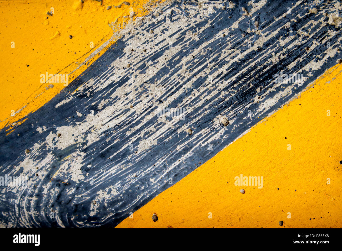 Yellow striped road markings on black asphalt Stock Photo