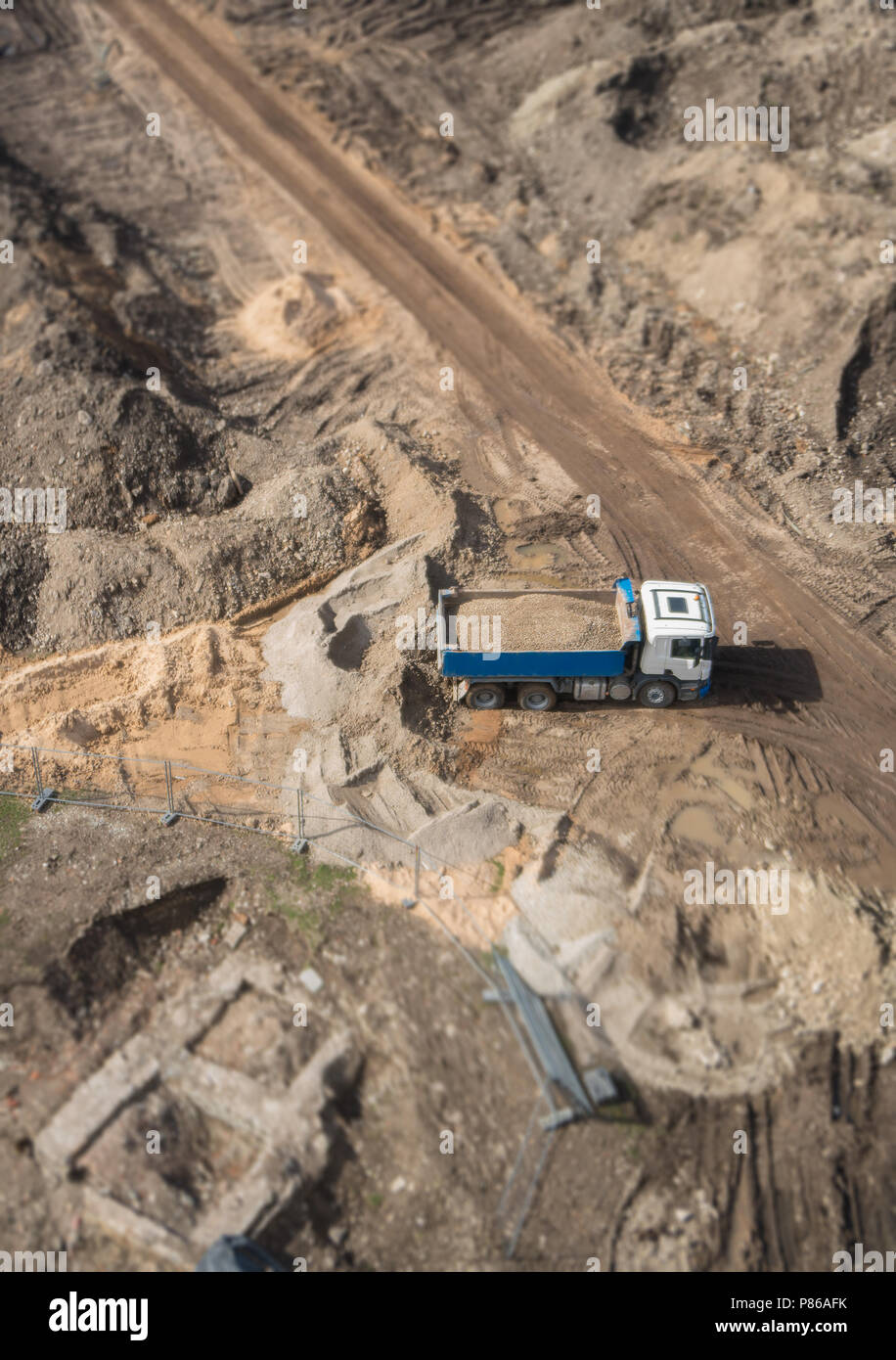 Truck with gravel on the construction site. View from above. - Stock Image