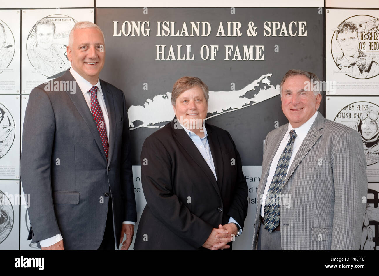Garden City, New York, USA. 21st June, 2018. L-R, Inductee former NASA astronaut MIKE MASSIMINO; and DEBORAH HENLEY, VP Executive Editor of Newsday, representing inductee aviator and Newsday founder Alicia Patterson; and LOUIS MANCUSO JR, representing his parents, inductees Louis and Carol Mancuso, pose at Cradle of Aviation Museum during Long Island Air & Space Hall of Fame Class of 2018 Induction. Credit: Ann Parry/ZUMA Wire/Alamy Live News - Stock Image