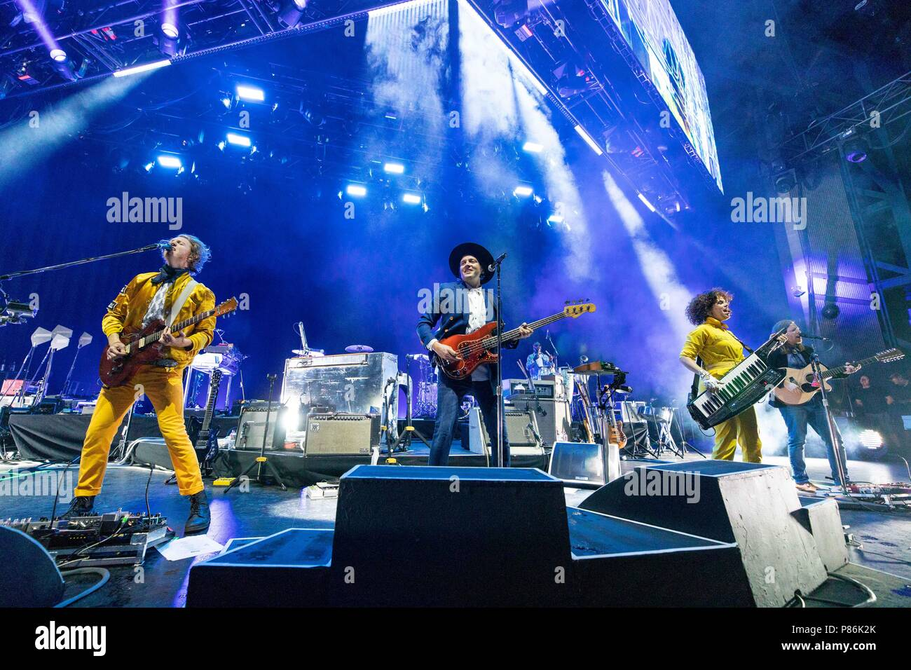 Milwaukee, Wisconsin, USA. 8th July, 2018. RICHARD REED PARRY, WIN BUTLER, REGINE CHASSAGNE and TIM KINGSBURY of Arcade Fire during Summerfest Music Festival at Henry Maier Festival Park in Milwaukee, Wisconsin Credit: Daniel DeSlover/ZUMA Wire/Alamy Live News - Stock Image