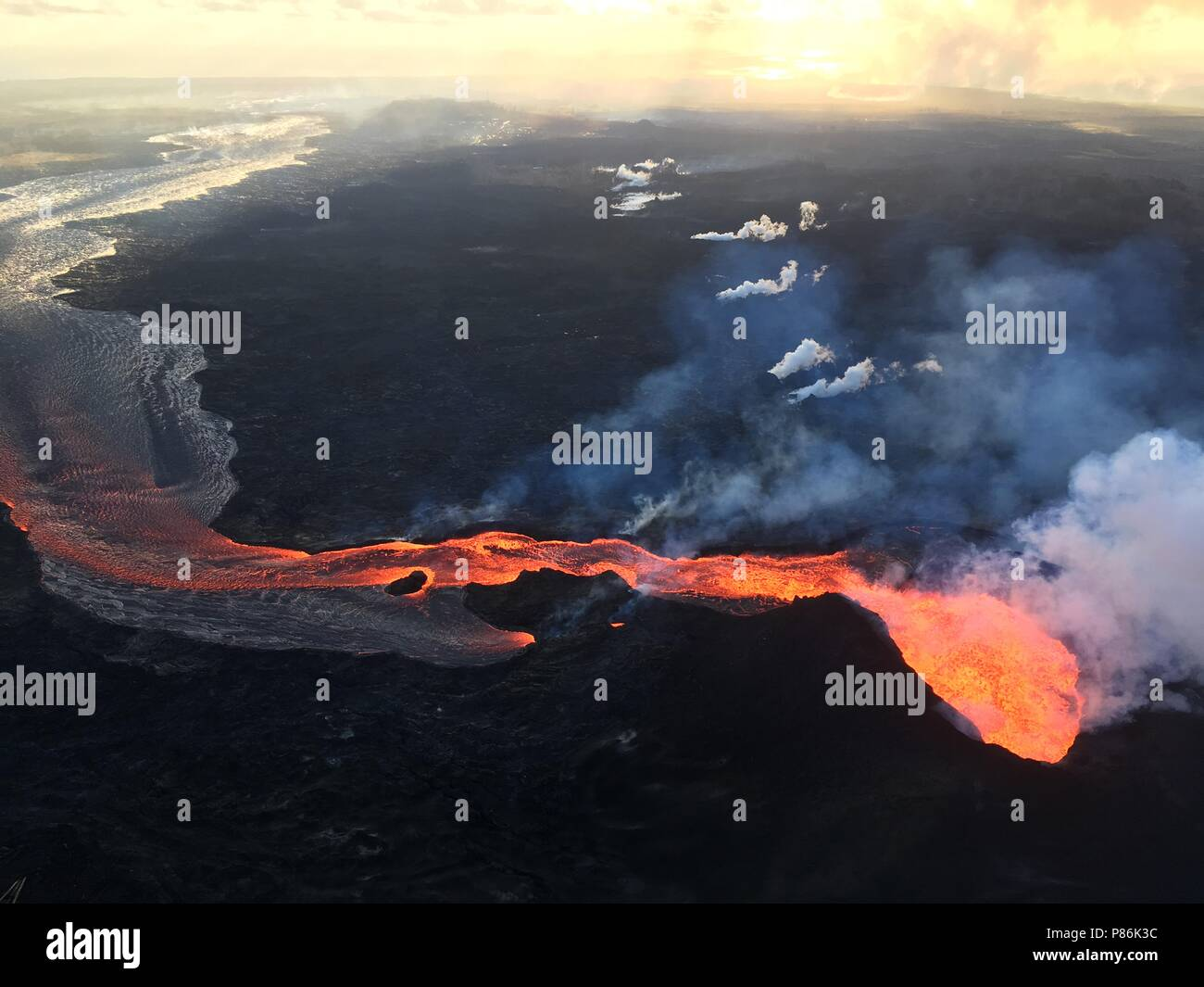 Hawaii. 9th July 2018. Lava flows toward the ocean from the Kilauea volcano July 9, 2018 in Hawaii. The recent eruption continues destroying homes, forcing evacuations and spewing lava and poison gas on the Big Island of Hawaii. Credit: Planetpix/Alamy Live News Stock Photo