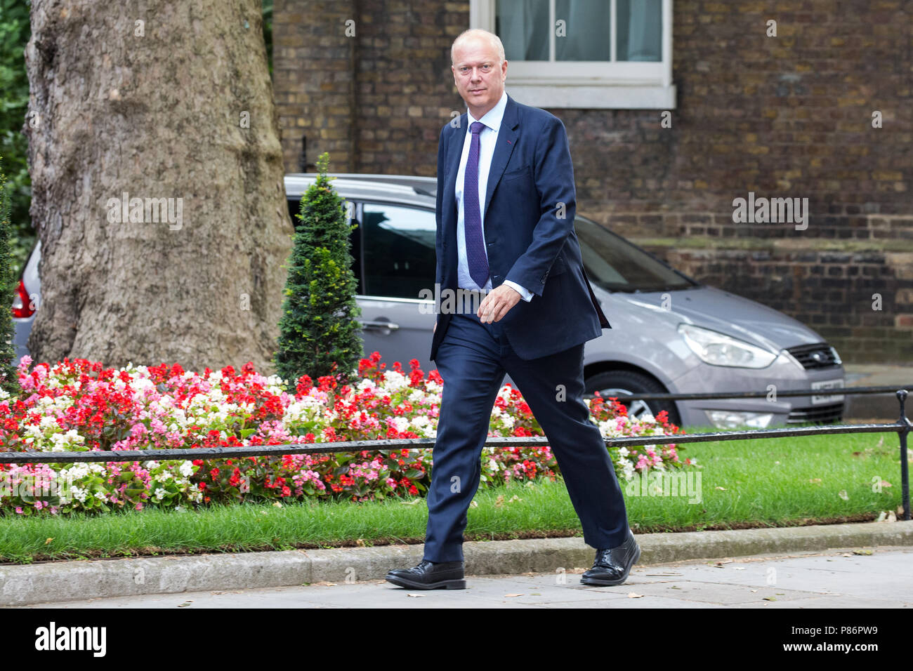 London, UK. 10th July, 2018. Chris Grayling MP, Secretary of State for Transport, arrives at 10 Downing Street for the first Cabinet meeting since the resignations as Ministers of David Davis MP and Boris Johnson MP. Credit: Mark Kerrison/Alamy Live News - Stock Image