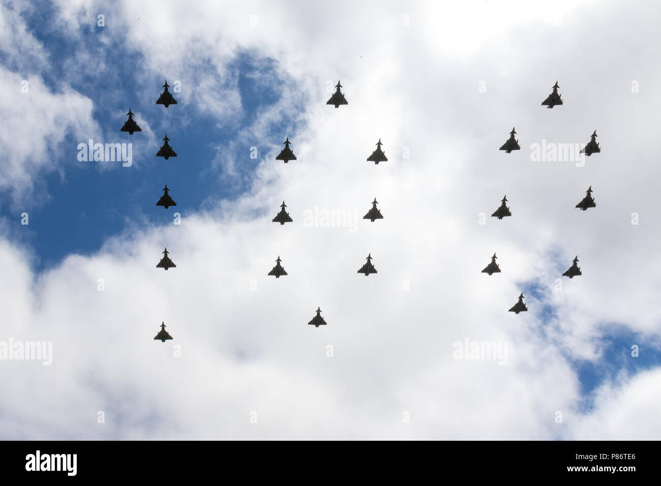London, UK. 10th July, 2018. Typhoon FGR4 in 100 formation taking part in RAF 100 flypast 10 July 2018 Credit: Gary Woods/Alamy Live News - Stock Image