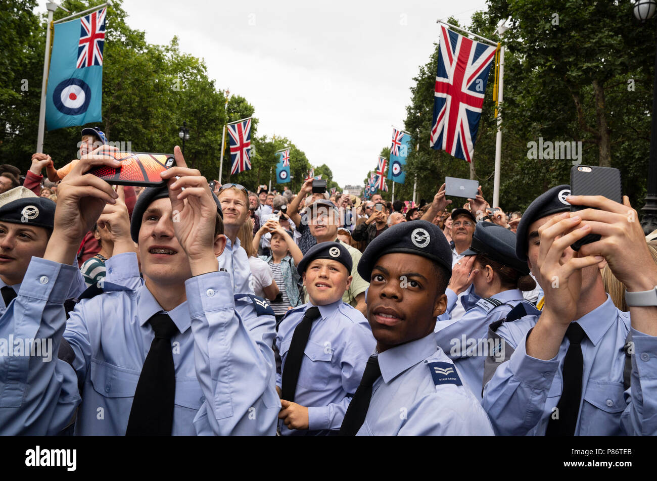 London, UK. 10th July, 2018. Air Training Corps cadets watch the flypast on the Mall, in London of the RAF 100 Flypast on July 10, 2018. Photo by David Levenson Credit: David Levenson/Alamy Live News - Stock Image