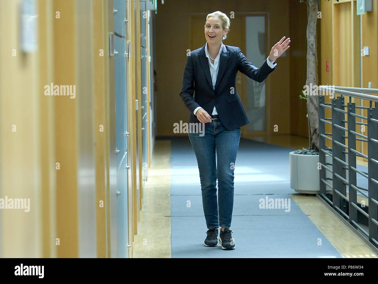Berlin, Germany. 10th July, 2018. Alice Weidel, parliamentary group leader of the Alternative for Germany (AfD) in the German Bundestag, walks to a press statement on the 'Masterplan Migration', which was previously presented by the German Minister of the Interior. Credit: Britta Pedersen/dpa-Zentralbild/dpa/Alamy Live News - Stock Image