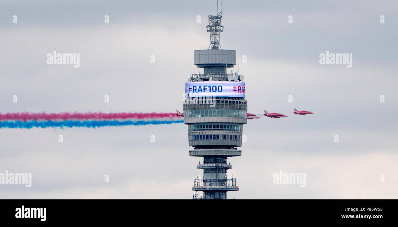 London, England, June 10th 2018, the world famous Red Arrows of the Royal Air Force Aerobatic Team display their true colours as they pass behind the BT Tower in London on their way to Buckingham Palace to celebrate the 100th Anniversary of the founding of the Royal Air Force. Credit: Louis Berk/Alamy Live News - Stock Image