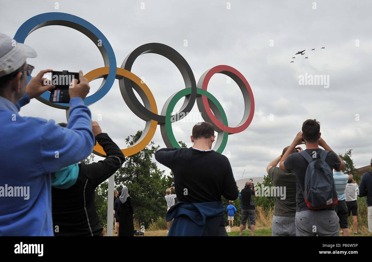 Stratford, London, UK. 10th July, 2018. Lancaster leads the Spitfires and Hurricanes over the Olympic rings. Royal Air Force (RAF) 100 years celebration flypast. Queen Elizabeth Olympic Park. Stratford. London. UK. 10/07/2018. Credit: Sport In Pictures/Alamy Live News - Stock Image