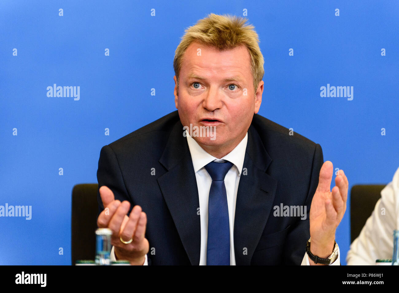 Minister of state at the ministry of Interior, Construction and Homeland Dr. Helmut Teichmann during the presentation of the 'Masterplan Migration - Measures to Organize, Control and Limit Immigration.' The plan includes stopping and rejecting migrants who are already registered in other EU countries at the German border. - Stock Image