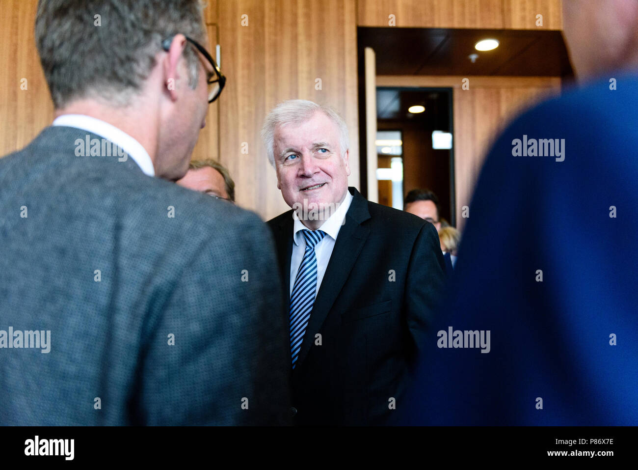 Berlin, Germany. 10th July, 2018. German Federal Minister of Interior, Construction and Homeland, Horst Seehofer of the Christian Social Union (CSU) talks to journalists after the presentation of the ''Masterplan Migration - Measures to Organize, Control and Limit Immigration.'' The plan includes stopping and rejecting migrants who are already registered in other EU countries at the German border. Credit: Markus Heine/SOPA Images/ZUMA Wire/Alamy Live News - Stock Image