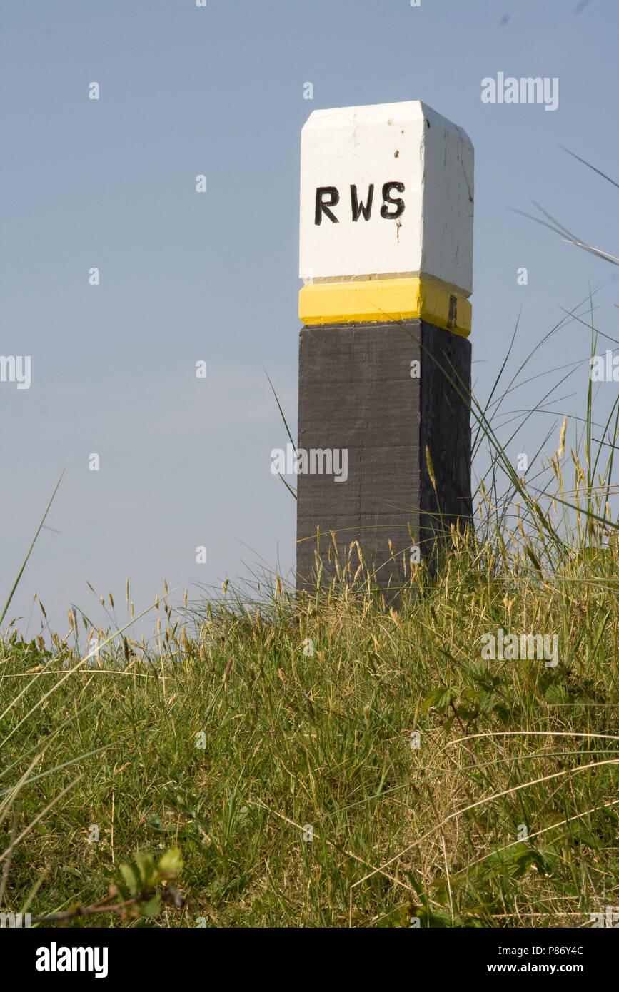 Strandpaal op Schiermonnikoog; Pole on Schiermonnikoog Stock Photo
