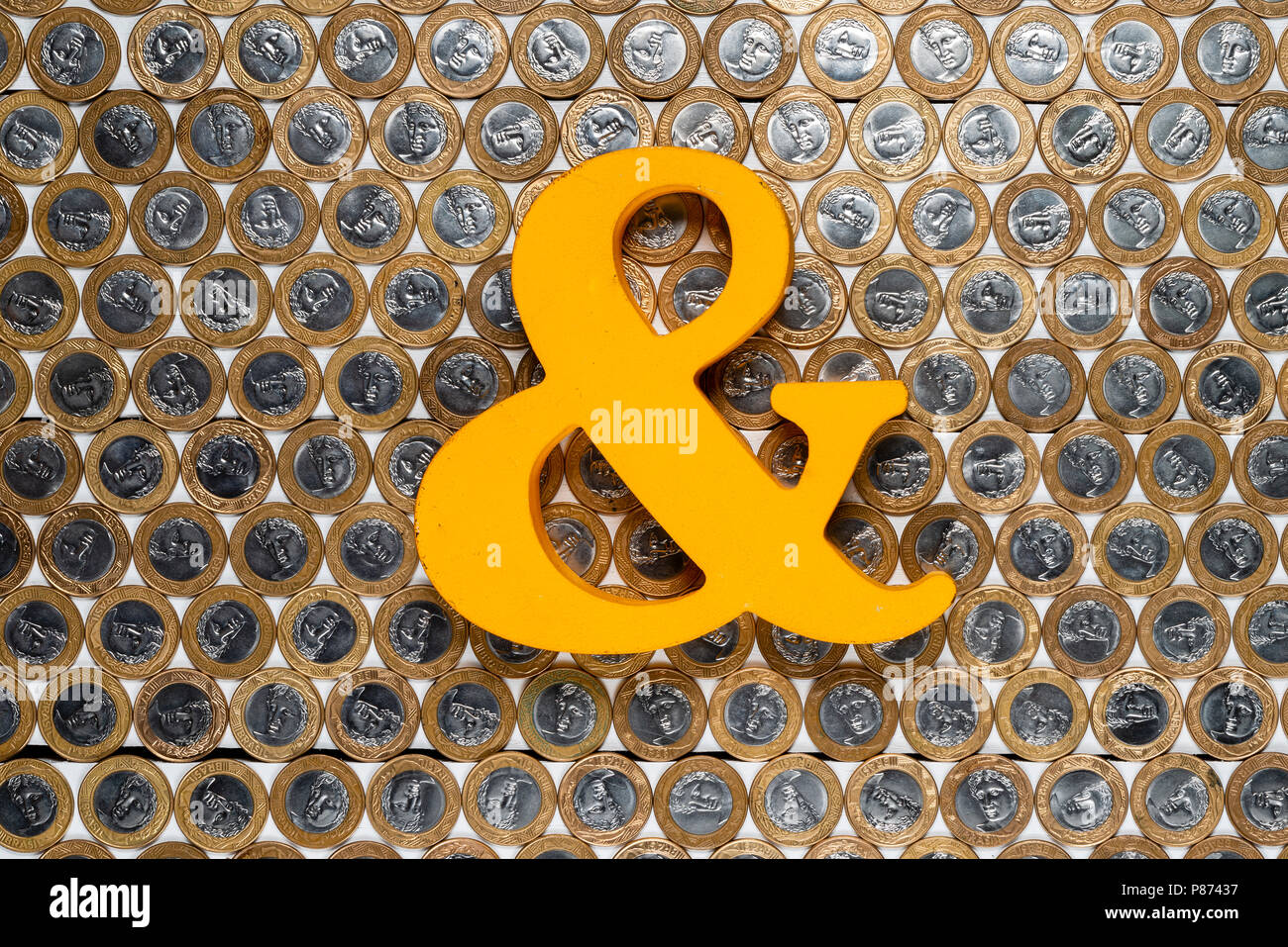 Ampersand on several Brazilian one real coins - Stock Image