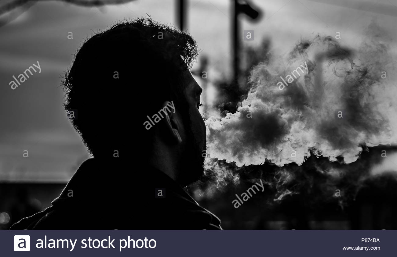Man Smoking - Stock Image