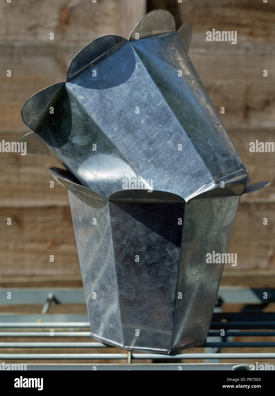 Close-up of galvanized zinc pots before being painted - Stock Image