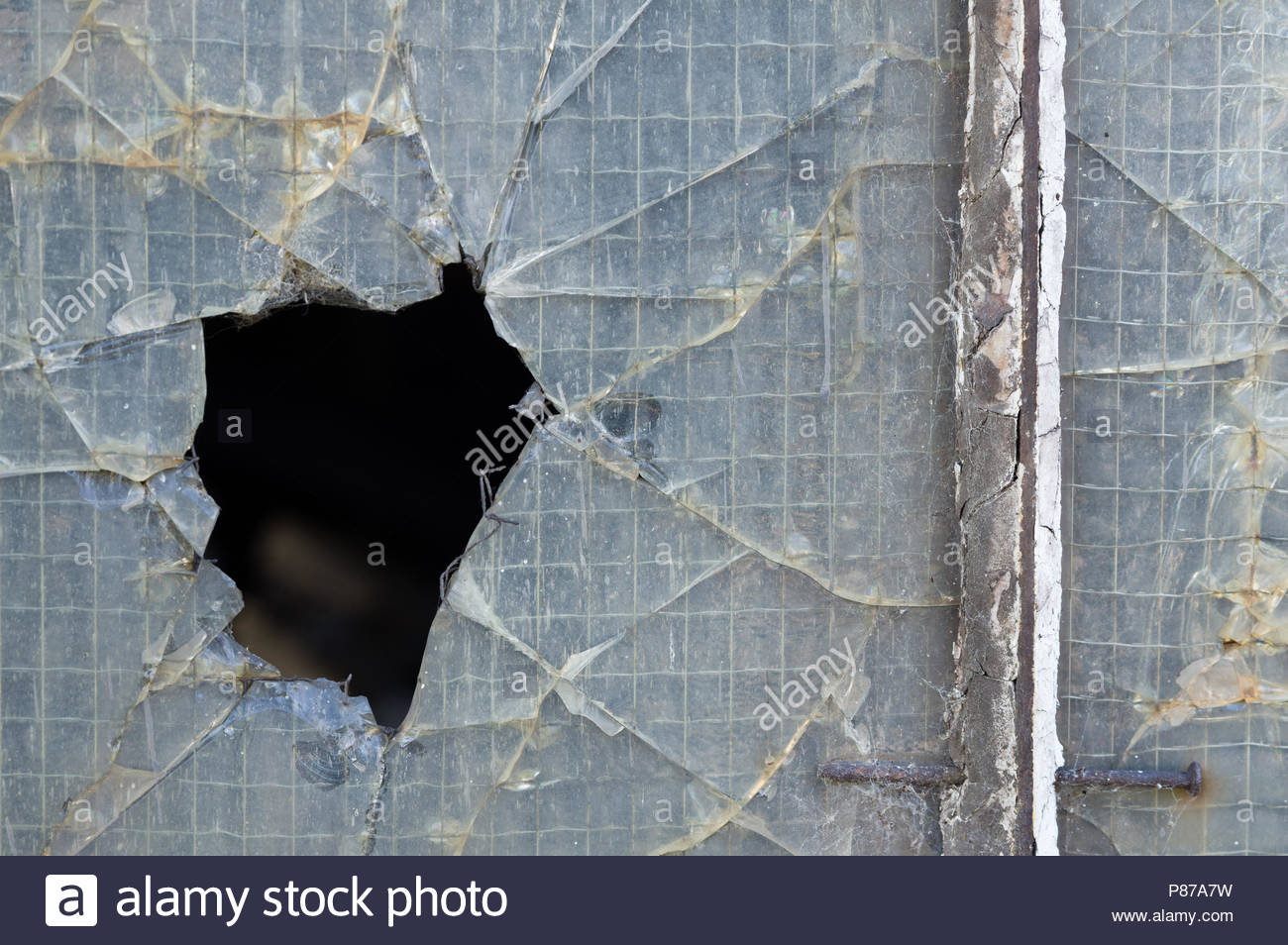 Cracked Reinforced Glass Window Stock Photos & Cracked Reinforced ...