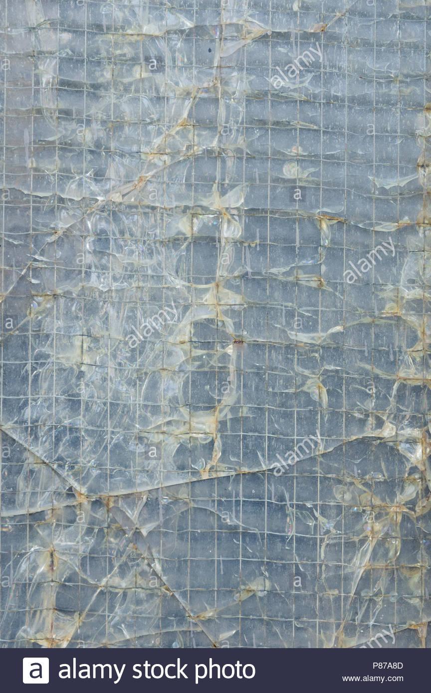 Broken Industrial Window Wire Mesh Stock Photos & Broken Industrial ...
