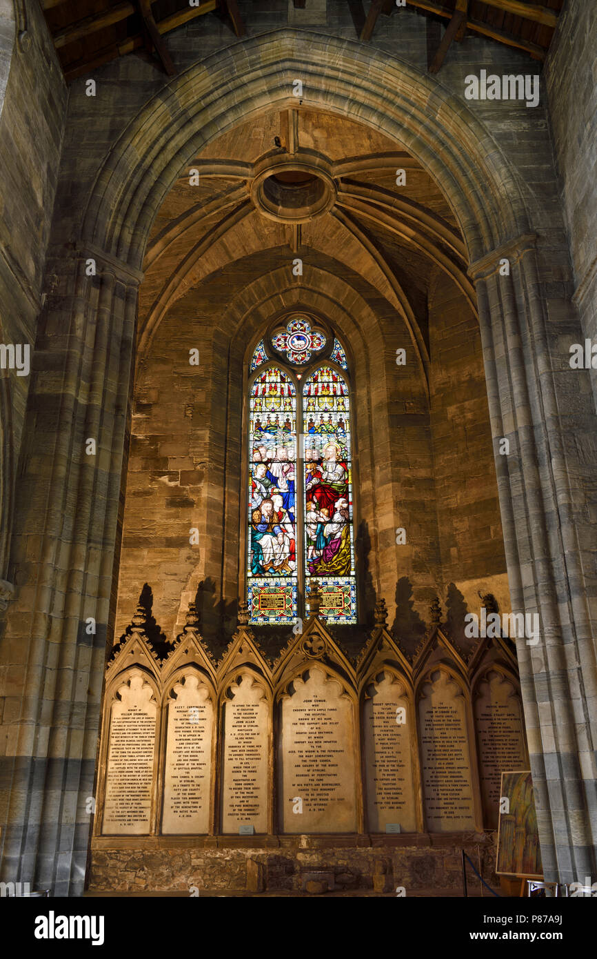 Stained glass window of Jesus Christ teaching at the back of the medieval Church of the Holy Rude with memorials to benefactors Stirling Scotland - Stock Image