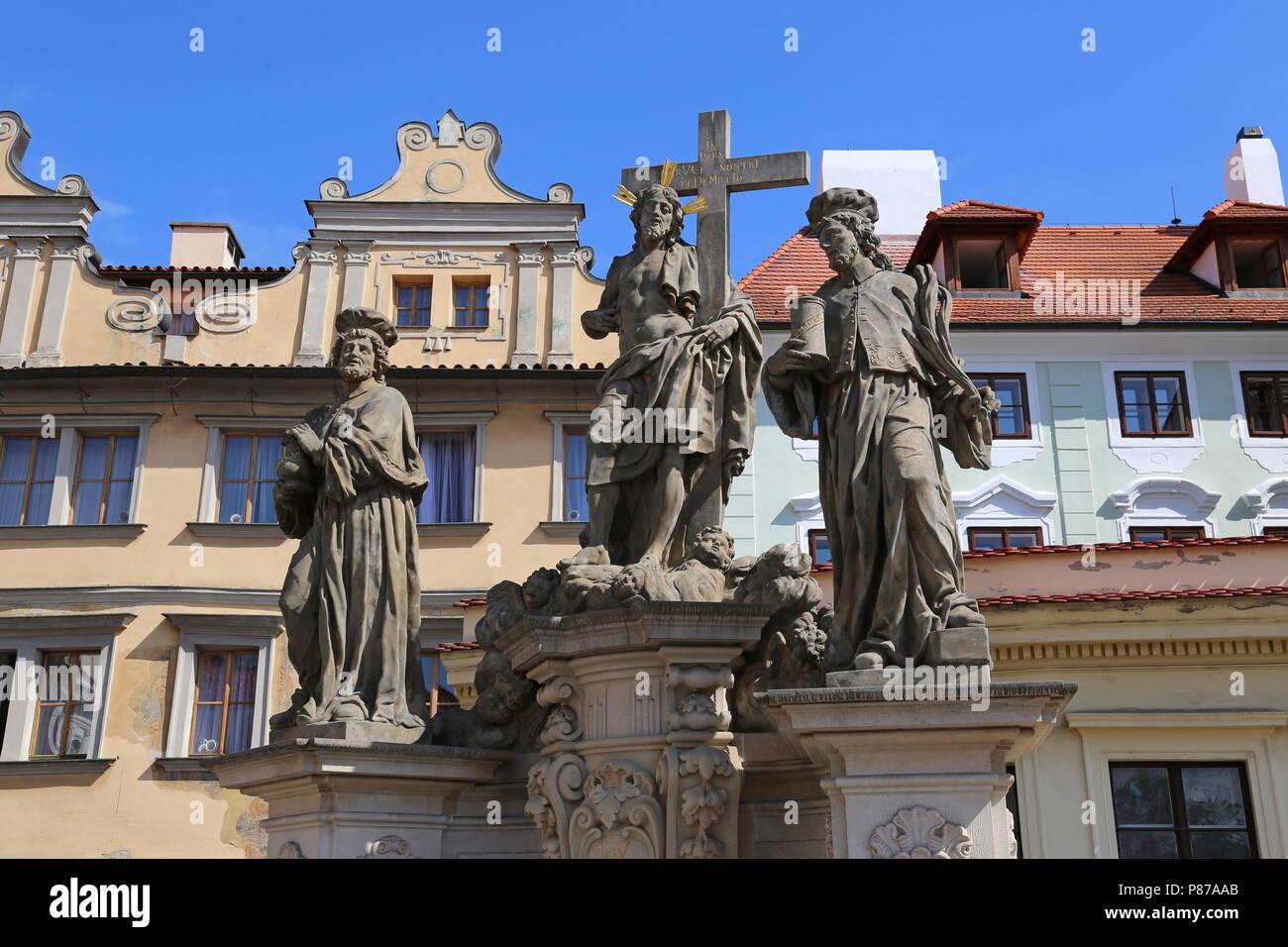 Christ between St Cosmas and St Damian, Charles Bridge, Prague, Czechia (Czech Republic), Europe - Stock Image