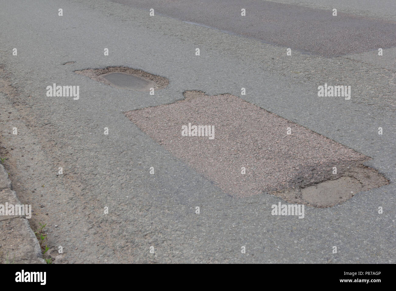 Pot holes in Carterton, Oxfordshire UK. 13th May 2018. UK Weather: Pot holes in West Oxfordshire, multiple potholes on the streets of Oxfordshire. - Stock Image