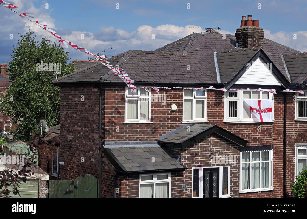 St George cross ed on white flags, flying in a residential street, Grappenhall, Warrington, Cheshire, North West England, UK - Stock Image