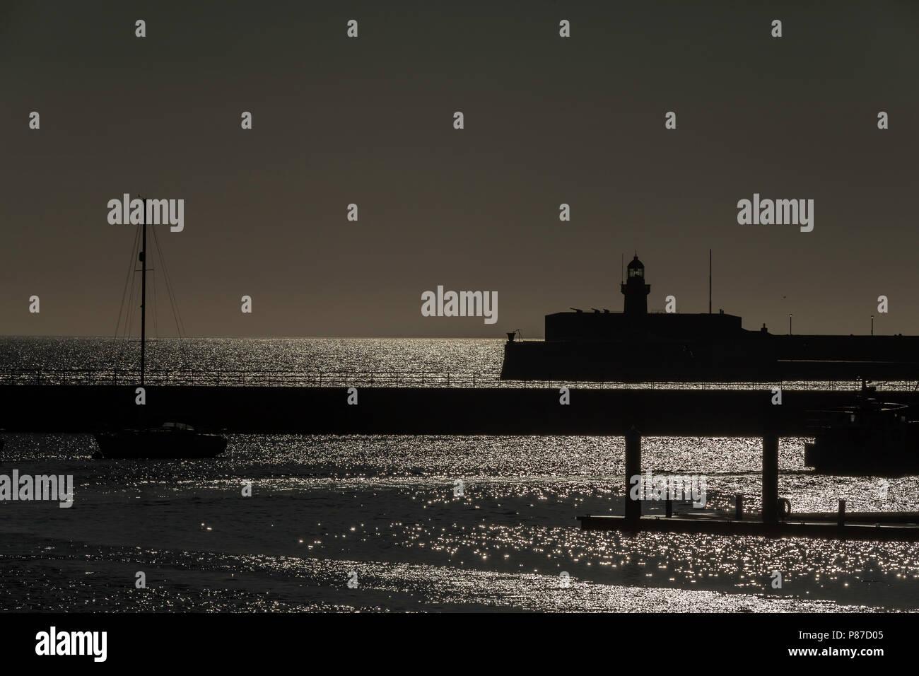 Lighthouse west pier Dun Laoghaire Dublin Ireland - Stock Image