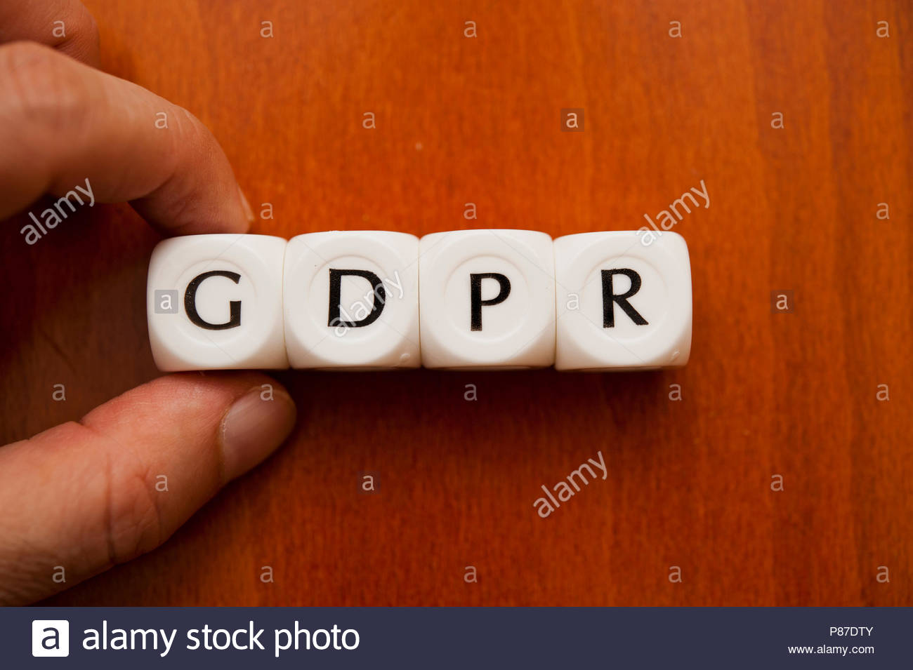 hand holding dice forming the word GDPR - General Data Protection Regulation - Stock Image