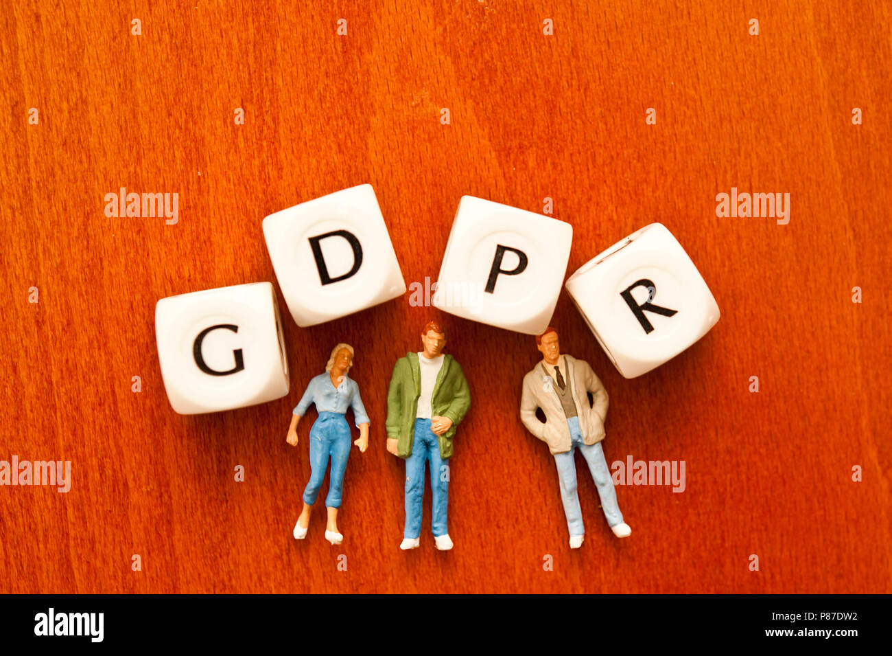miniature figurines and dice spelling the word GDPR - General Data Protection Regulation - Stock Image