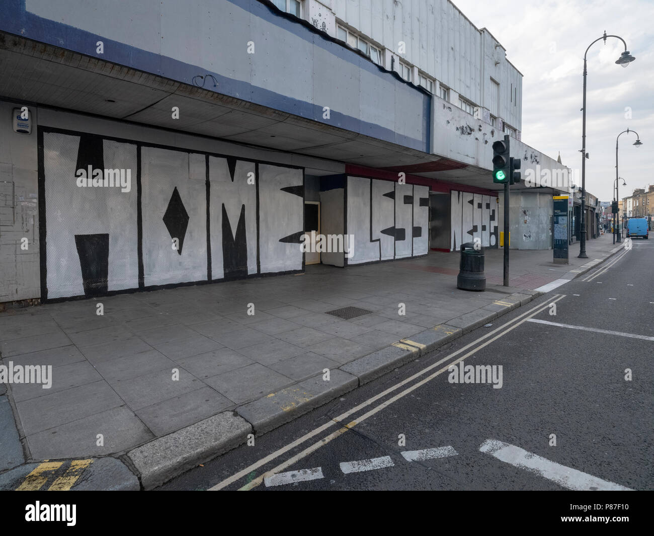 Kentish Town, London, Homelessness graffiti on the outside of an abandoned building making a statement about the need for more housing in London - Stock Image