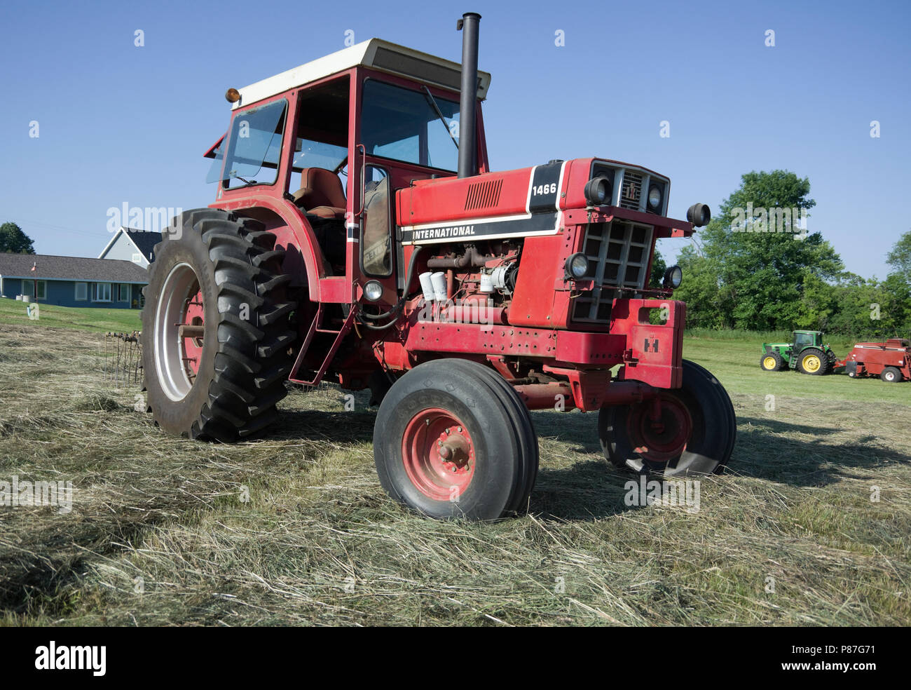 International Harvester model 1466 diesel Row Crop tractor in hay field