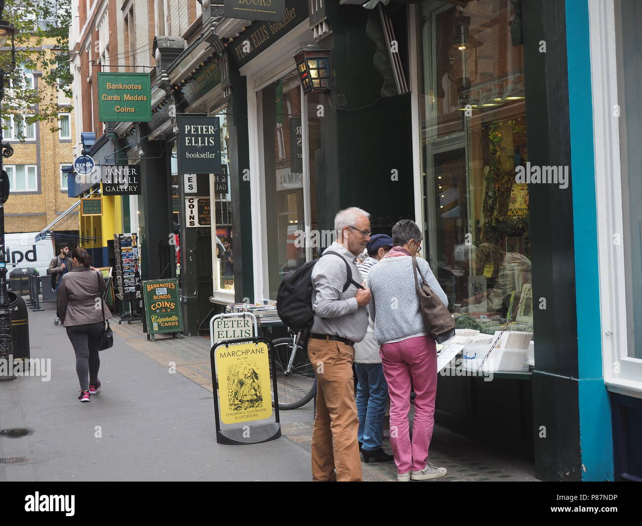 Cecil Court, a pedestrian only alley with shops selling collectors' items, shopping - Stock Image