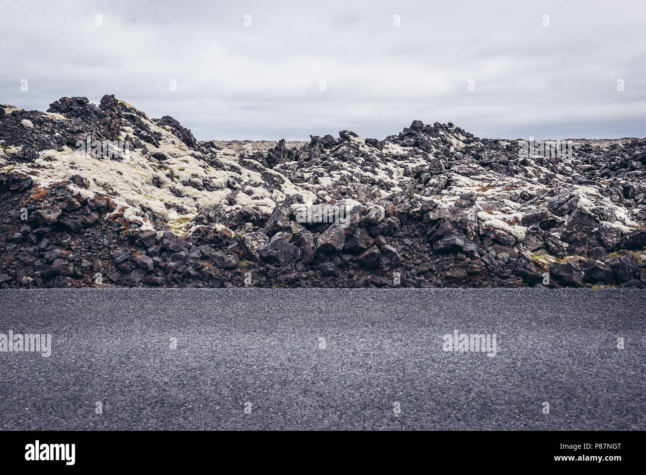 Lava field covered with moss next to route 425 on a Reykjanesskagi - Southern Peninsula in Southwest Iceland - Stock Image