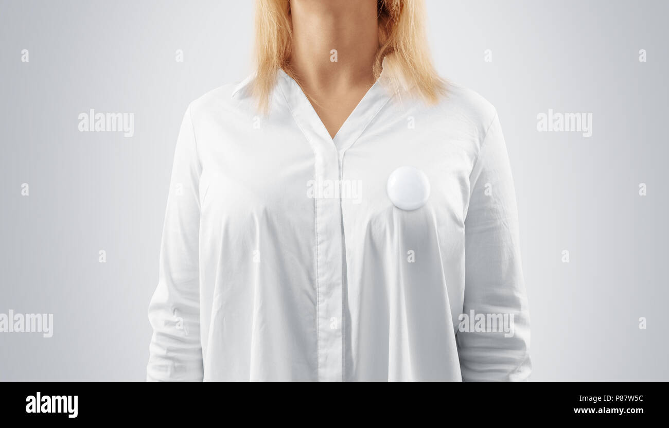 Blank button badge mockup pinned on the womans chest. Girl wear white shirt and campaign pin mock up. Volunteer round emblem design element. Pesron st Stock Photo