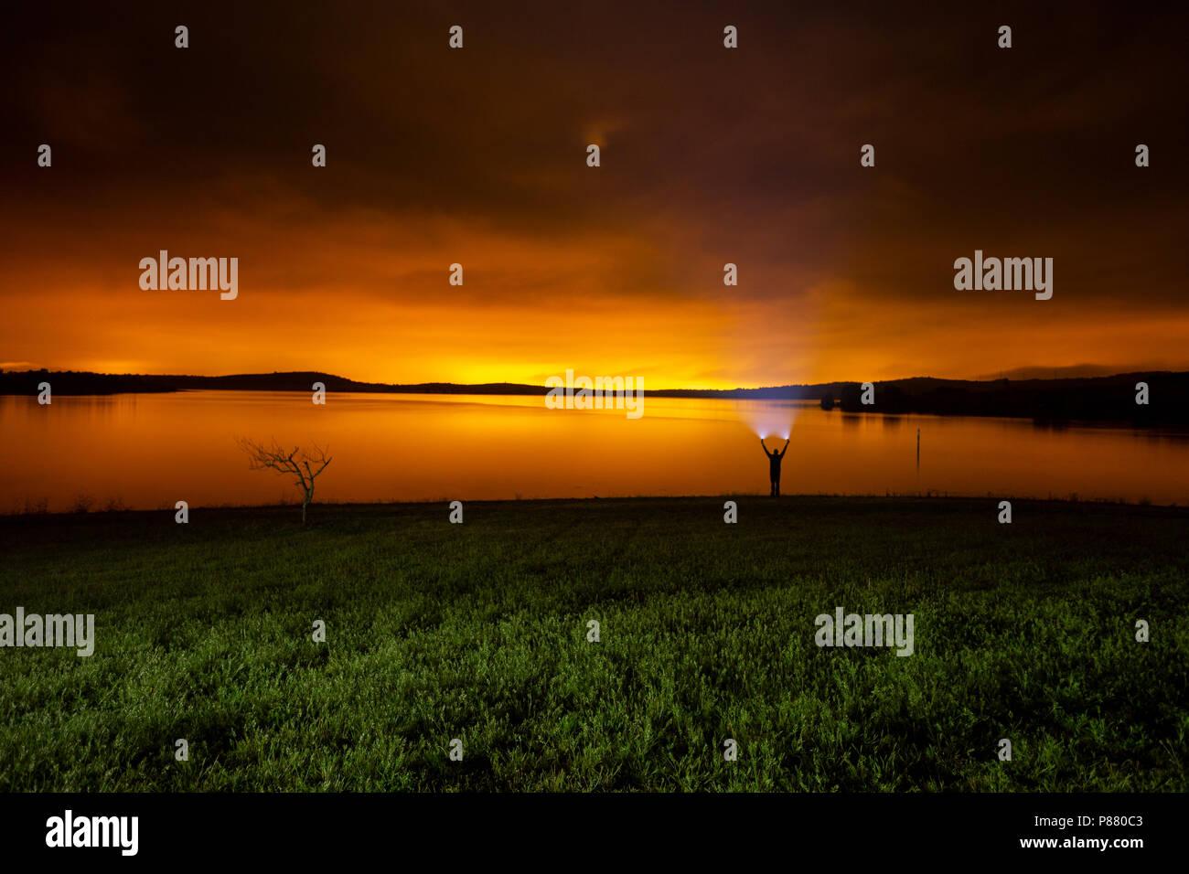 Luminic pollution from Vitoria at night in Ullibarri-Gamboa - Stock Image