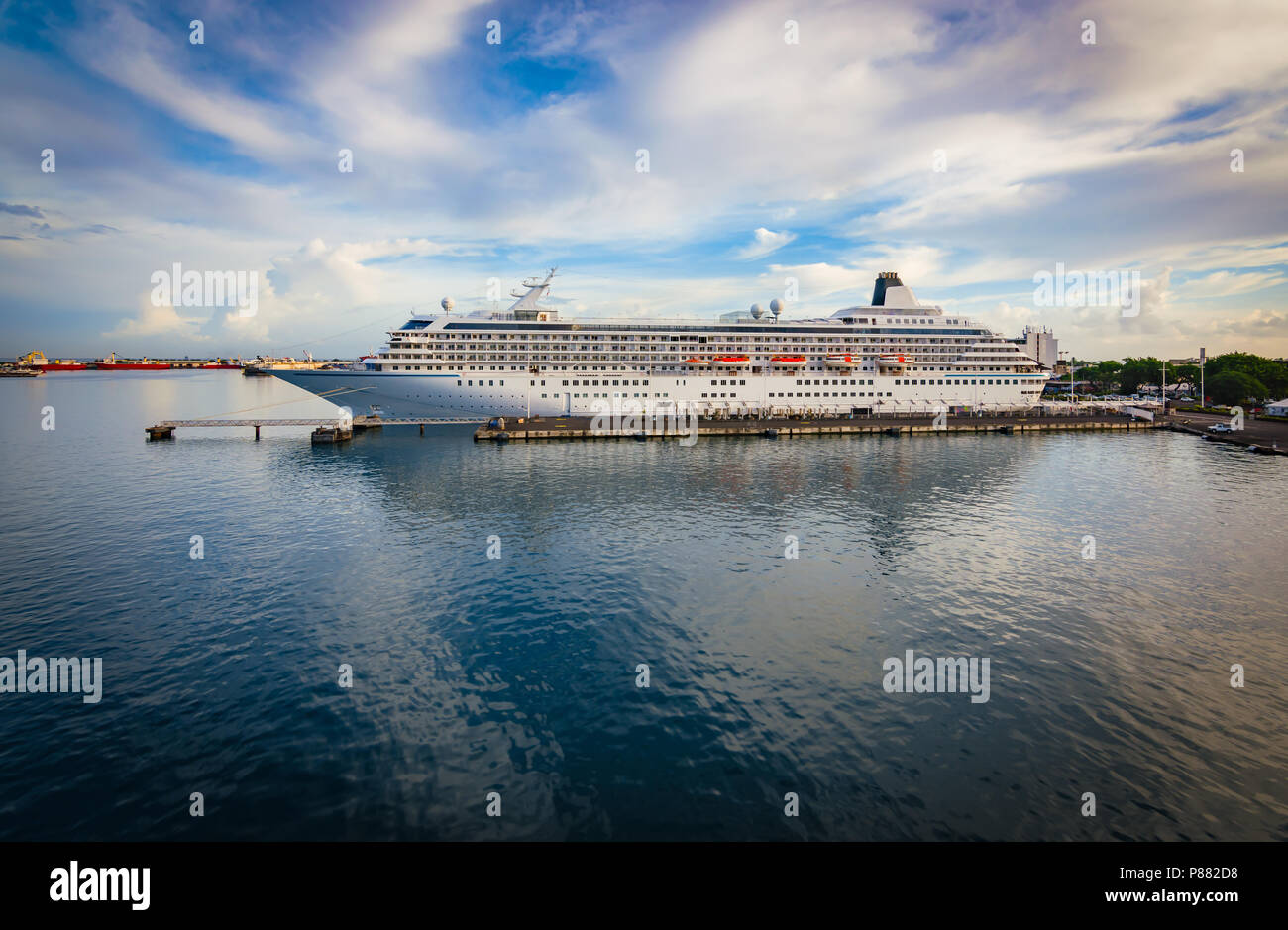 Luxury cruise ship docked in port. Stock Photo