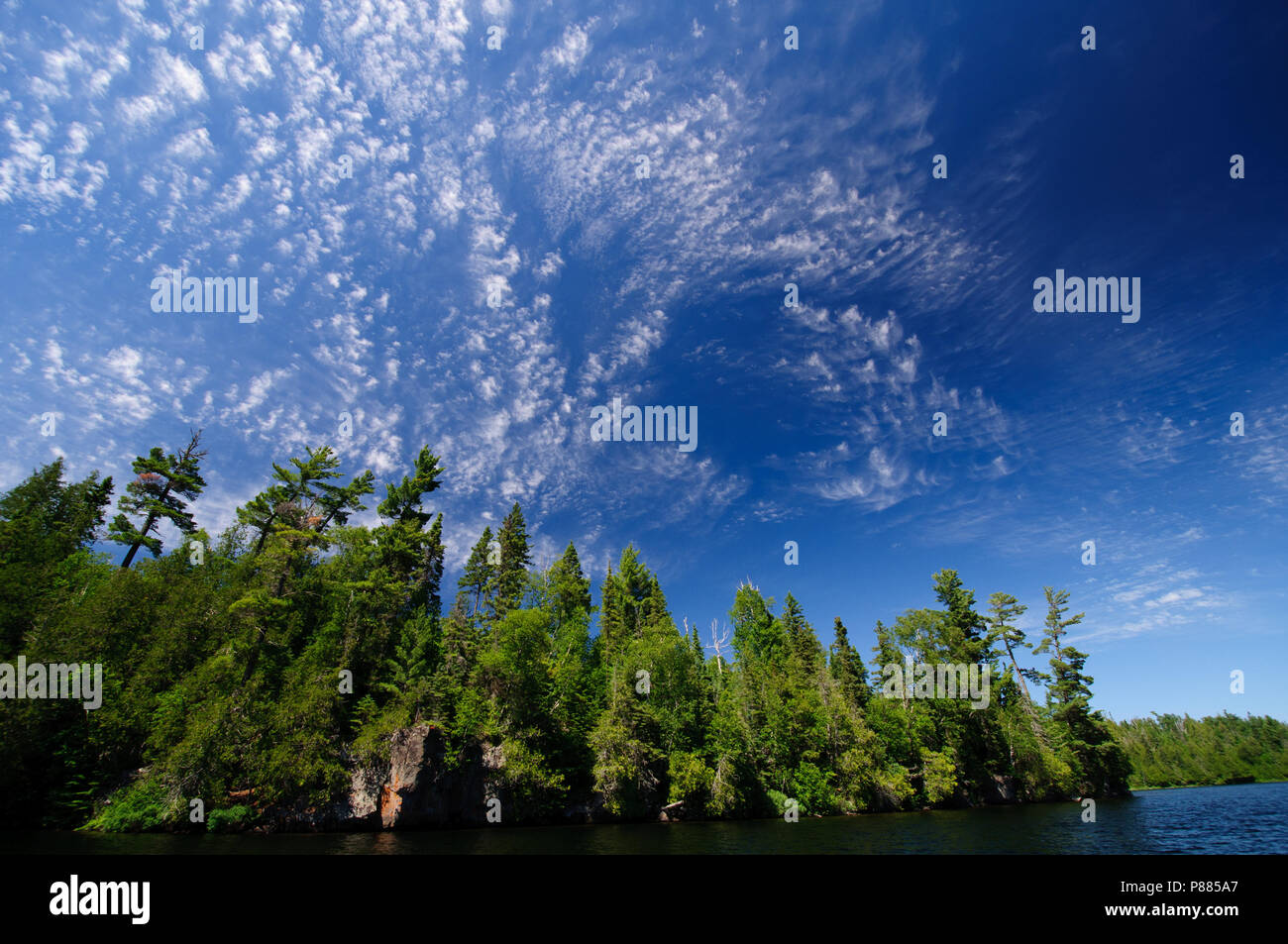 Cirrus clouds over Winchell Lake in the Boundary Waters - Stock Image