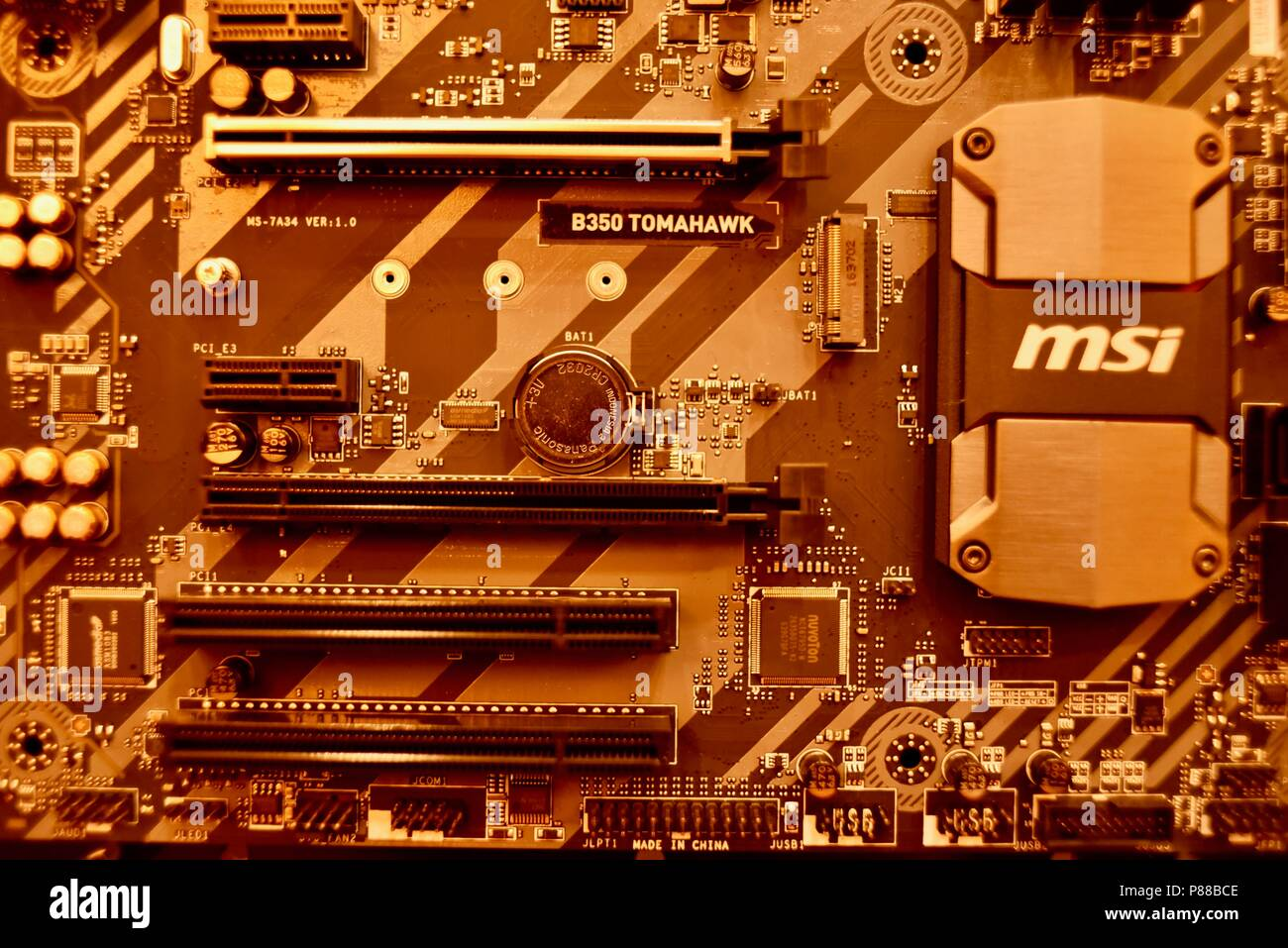 Close up of modern MSi computer B350 Tomahawk motherboard with PCIe slot, RAM slot, circuitry with MSi on display at the CES, in Las Vegas, NV, USA. - Stock Image